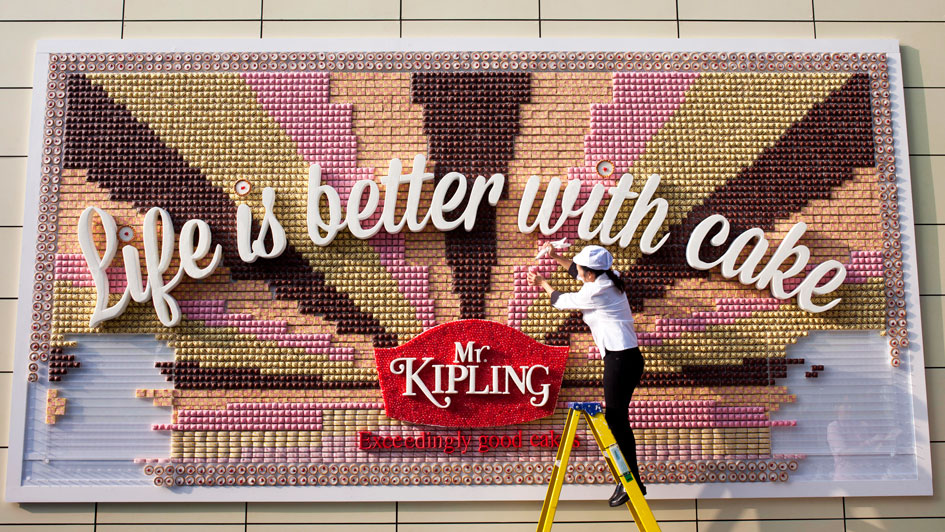 British cake company Mr. Kipling has built a billboard using tasty pieces of cake.